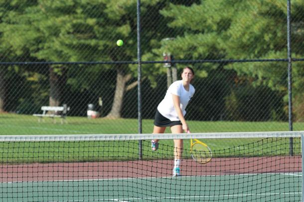 Senior Kate Rizzieri serves the ball across the court. The women's varsity tennis team is 3-2 overall.