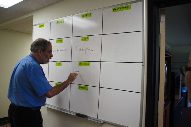 Resident supervisor Brother Steve Strausbaugh records the name of students on the white board. Residents must inform supervisors of where they are going at all times.