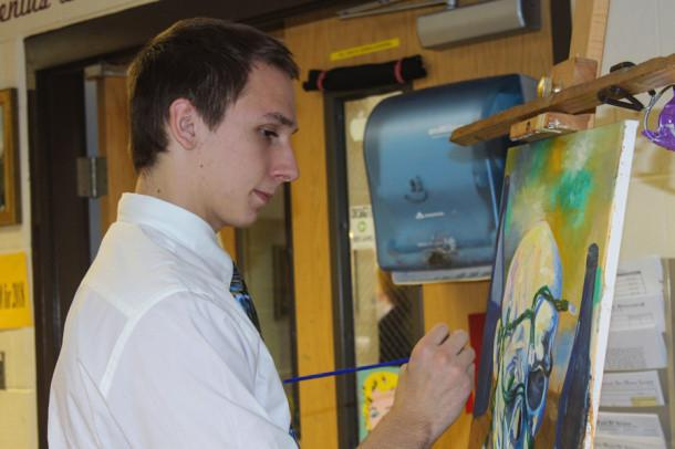 Senior Senior Thomas Jednorski works on a painting for his AP Studio class. He transferred from Gilman and is pursuing his passion for art.