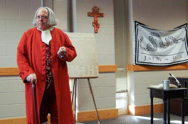 David Fisher, impersonating Ben Franklin, speaks at an event hosted by the History Club. This event, at which 203 students were present, took place Nov. 14.