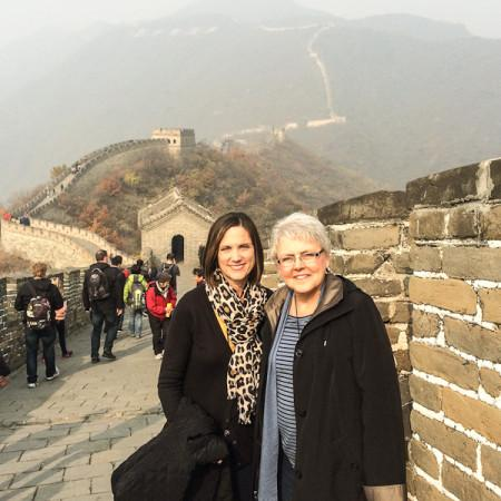 Principal Madelyn Ball and English department chair Christine Zurkowski pose on the Great Wall of China in Beijing. They went to China to promote JC to prospective international students.