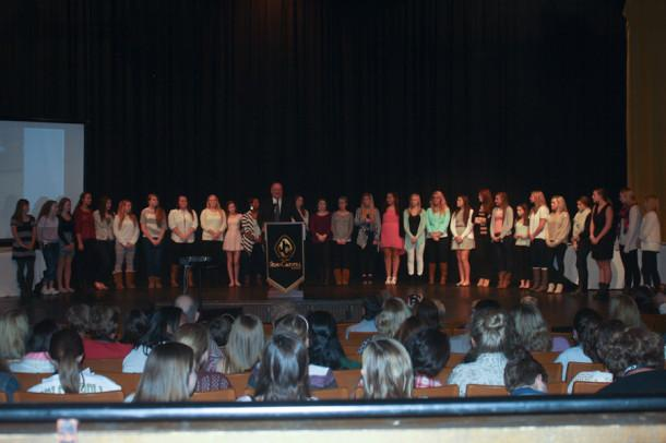 Athletic Director Lawrence Dukes presents the cheerleaders during the Sports Banquet. The cheerleaders won first and second place in the competitions that they competed in during the season.