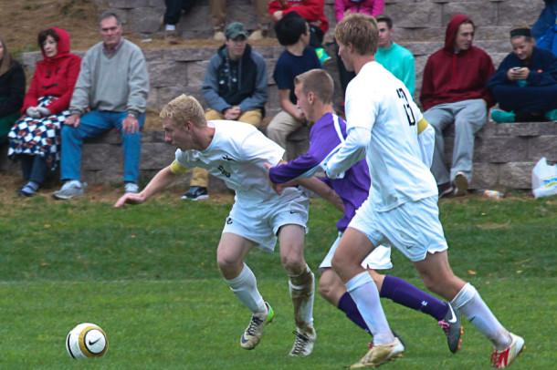 Seniors Zach Hammons and Colby Fell fight for the ball. JC beat Mount St. Joesph 1-0 on Oct. 23.