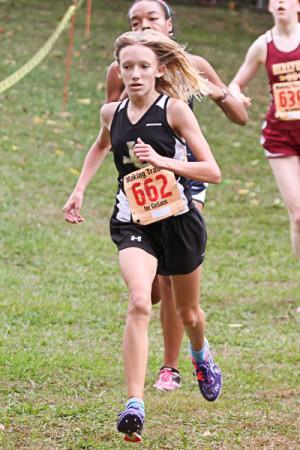 Freshman varsity runner Adria Pirozzi runs in the Barnhart invitational. The women's cross country record was 7-0 this season.