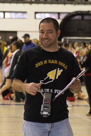 Cross country and indoor track coach Robert Torres finishes timing runners at the Essex meet in 2011. Torres has been coaching at JC for 12 years.