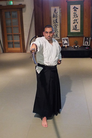 Help Desk Coordinator Joe Vitucci stands in his ready pose for aikido. Its philosophy is one cut one mind.