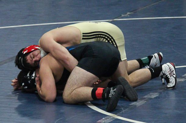 Junior Hunter Ritter wrestles senior Bryce Pappas from St. Mary's at the Early Bird Tournament on Nov. 30. Ritter has won both MIAA championships and the Maryland Independent School championship.
