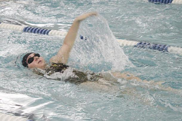Sophomore Megan Ingold swims the 100 meter backstroke event. The women's team lost 39-131.