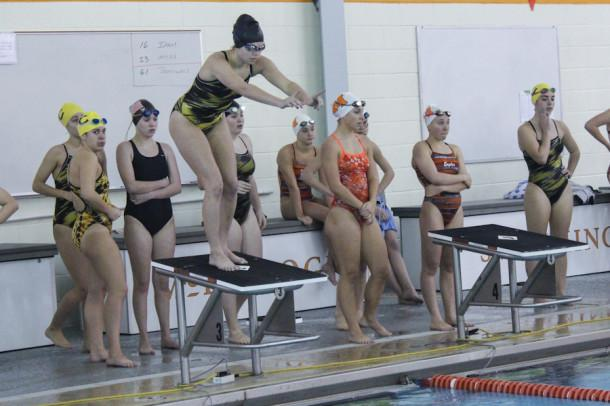 Sophomore Carly Lyon prepares to dive in the 200 free relay. The swim meet was away on Jan. 23 against McDonough.
