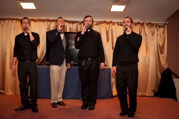 """Religion teacher Jonathan Gibbons (second from left) performs with his a capella group """"Sixtus"""" at a benefit for St. Joseph's House this past January. St. Joseph's House is a daycare for disabled children."""
