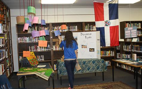 Students going on the Dominican Republic service trip set up a display in the library about life and culture in the Dominican Republic. The group wanted to raise awareness of the country in advance of their trip in June.