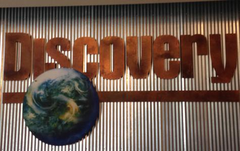 Senior Lauren Fabiszak captures the sign in the front lobby of the Discovery Channel in Silver Spring, Maryland on Monday, March 23rd. Fabizak visited  the Discovery Channel while on a field trip with her Senior Project group.