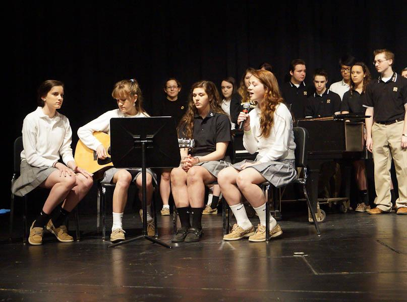 Sophomores+Lilly+Stannard%2C+Kathleen+O%27Neill%2C+and+Nicolette+Ficca%2C+and+freshman+Olivia+Lang%2C+all+part+of+Level+Infinity%2C+perform+at+the+quarter+three+academic+awards+ceremony.+They+played+two+of+their+songs+during+the+ceremony.