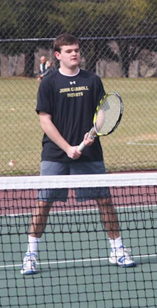 Junior Justin Hawkins waits at the neat for a volley. Hawkins has been playing tennis for four years and enjoys it as his favorite outdoor activity.
