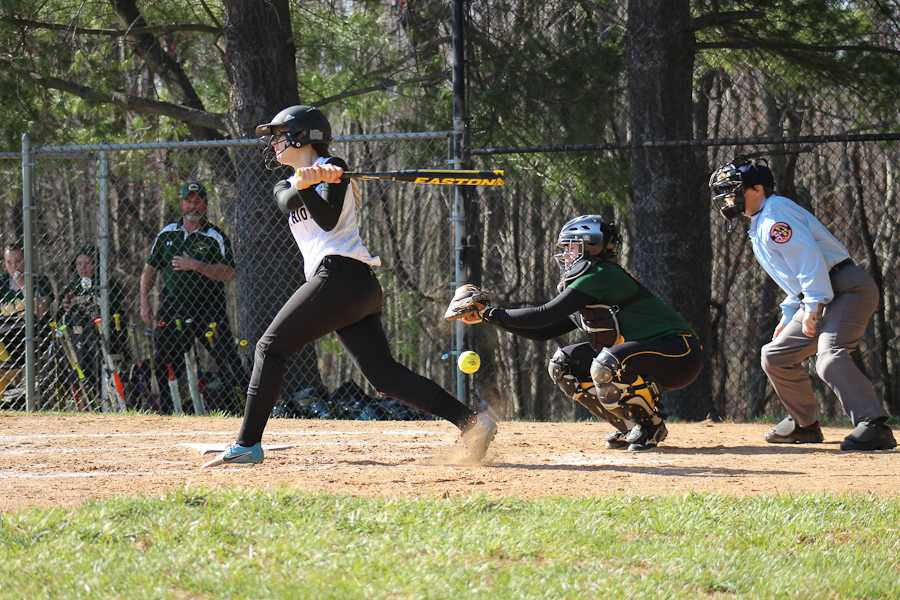 Varsity+third+baseman+freshman+Sarah+Meyerl+swings+at+strike+three+against+Catholic+High+on+a+game+on+April+4.+Due+to+a+passed+ball+and+a+throwing+error%2C+Meyerl+was+able+to+get+on+base+and+eventually+score+a+run.