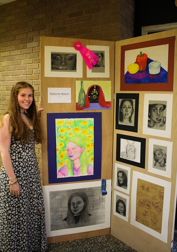 Sophomore Kate Runser displays her artwork at the Fine Arts Show on May 15. Runser won Best in Show for her drawings as well as first place for her self-portrait.
