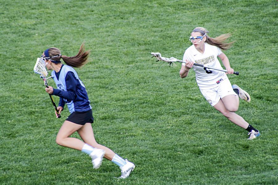 Sophomore Parker Day (6) pursues the ball during JV women's lacrosse against Mount de Sales April 23. JV won the game 16-7.