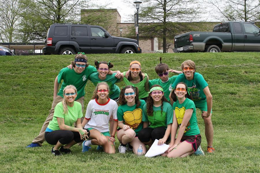 "(Top Row from left to right:) Seniors Matt Wagner, Catey Minnis, Megan Grieg, Dan Hentschel, Travis Nelson, (Bottom Row from left to right:) Lindsey McCumber, Rachel Weskalnies, April Moscati, Karly Horn, and Caitlin Wolfarth pose as the ""Teenage Mutant Ninja Turtles."" Each team for field day had a theme in which they dressed."