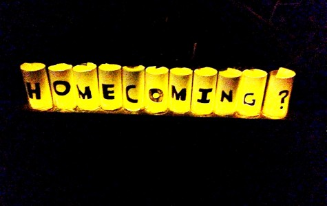 Junior John Perry set up candles for junior Alice Cumpston to ask her to homecoming. Cumpston was surprised when she got to the bottom of her driveway to this proposal.