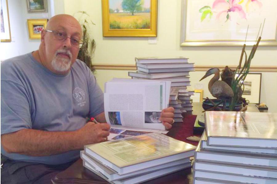 Art teacher Bruno Baran signs copies of Gary Pendleton's