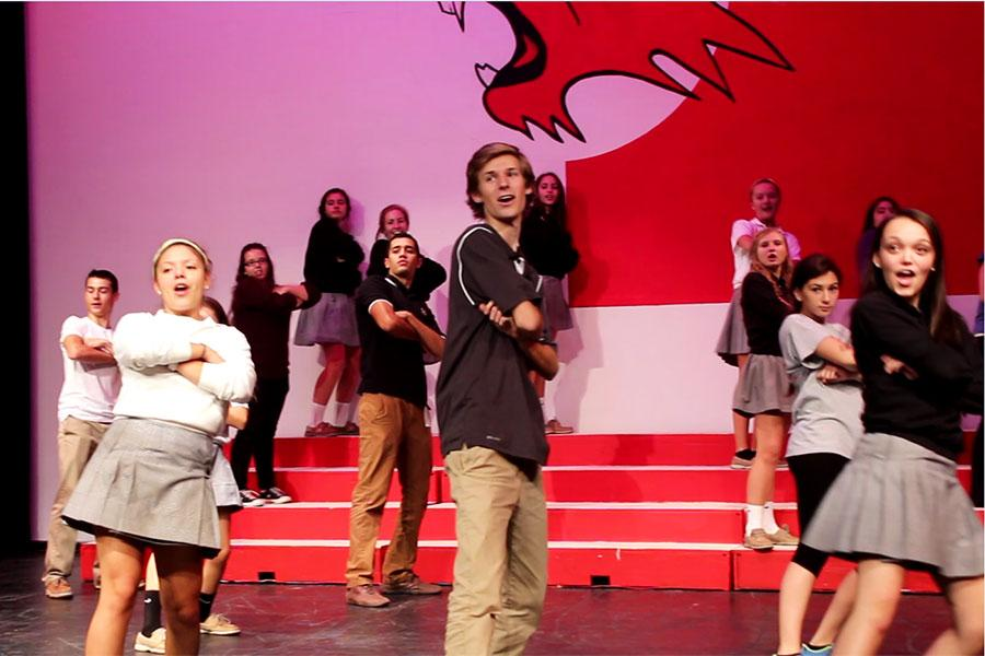 Students participating in High School Musical rehearse