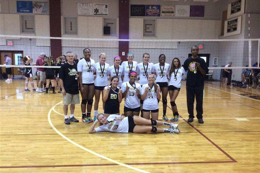 Varsity women's volleyball team poses after winning gold at a noncompetitive tournament. The tournament took place Sept. 23.