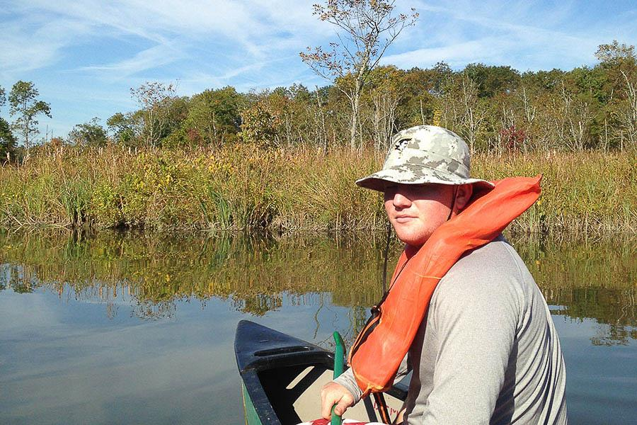 Senior Ryan Sheehan explores Dundee Creek on his Marine Biology canoe trip. The trip was lead by Amy Hughes who taught students about the wildlife that depends on Dundee Creek for a living.