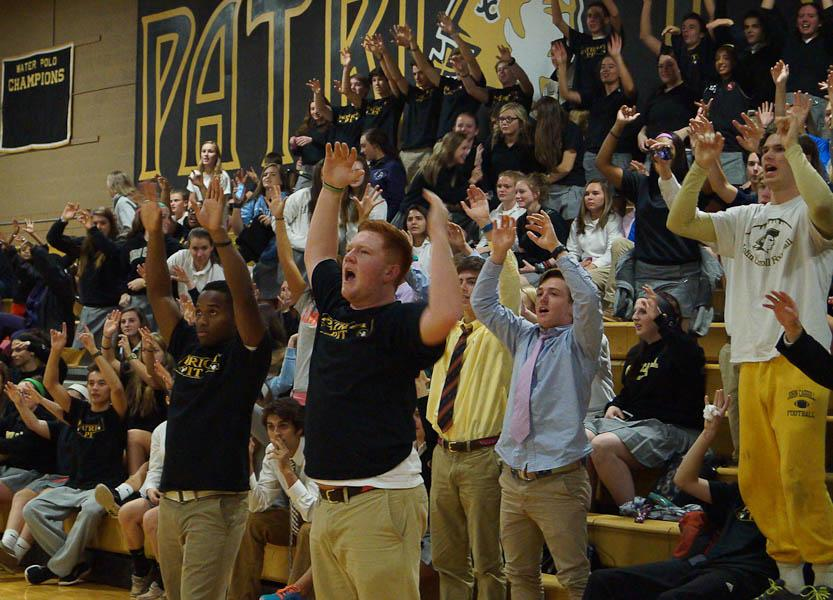 Seniors+Ryan+Sheehan+and+Allen+Bryant+throw+their+hands+up+in+their+air+and+lead+a+chant+during+the+basketball+rally.+The+rally+was+held+on+Nov.+13+to+raise+excitement+for+the+upcoming+basketball+season.