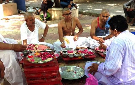 Editor Kishan Patel pays close attention to the Brahmins' instructions about the yagna, the spiritual ritual in which Patel took part. Patel went to India in order to be a part of the four hour long yagna to honor his late grandfather's soul.