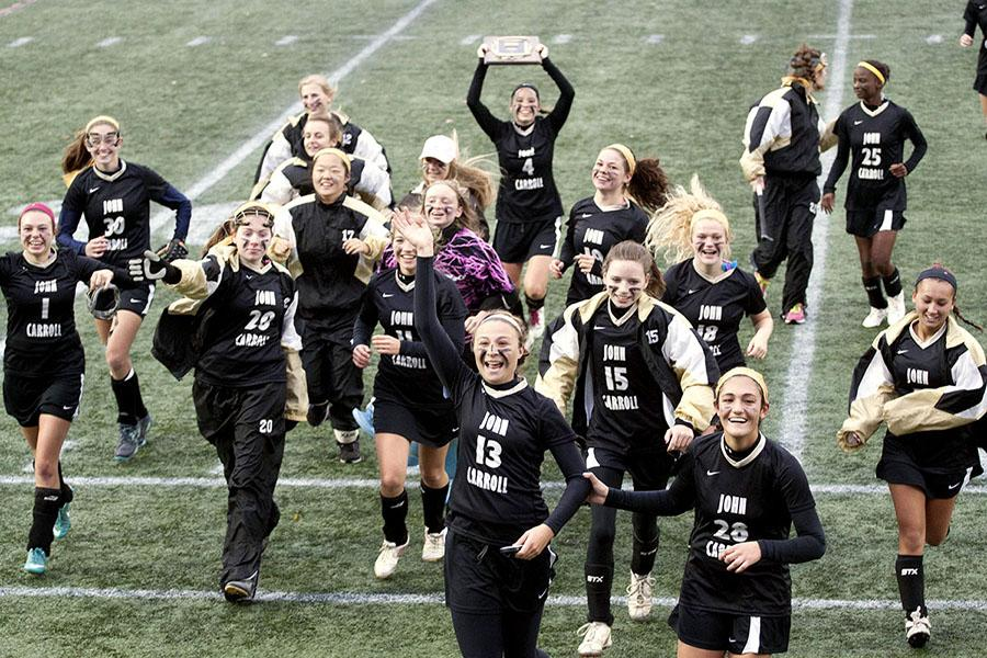 The field hockey team rushes towards the fans after their 2-1 win against Maryvale in the championship on Nov. 1. The team won the championship for the first time since 2005, which was also against Maryvale but ended in a tie.