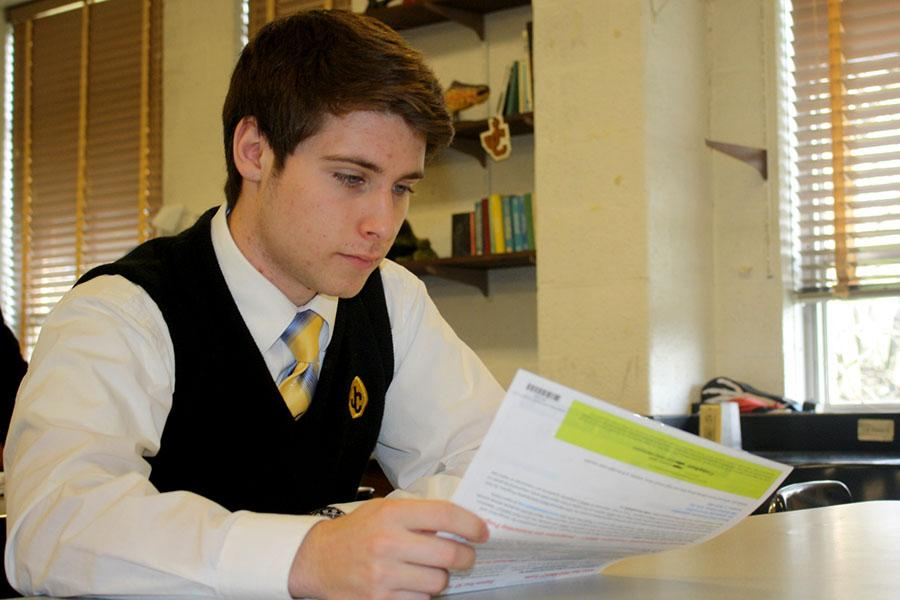 Junior Alex Nyce reads his PSAT score report. Juniors received their score reports in Junior Guidance during the week of Dec. 8-12.