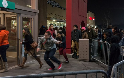 Crowds of eager shoppers storm Target on Black Friday as the doors open. This day has become a phenomena around the world, and kicks off the holiday shopping season.