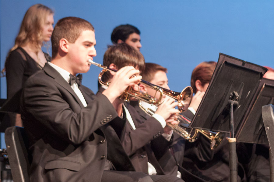 Freshman Jonathan Kaufman plays the trumpet during the song