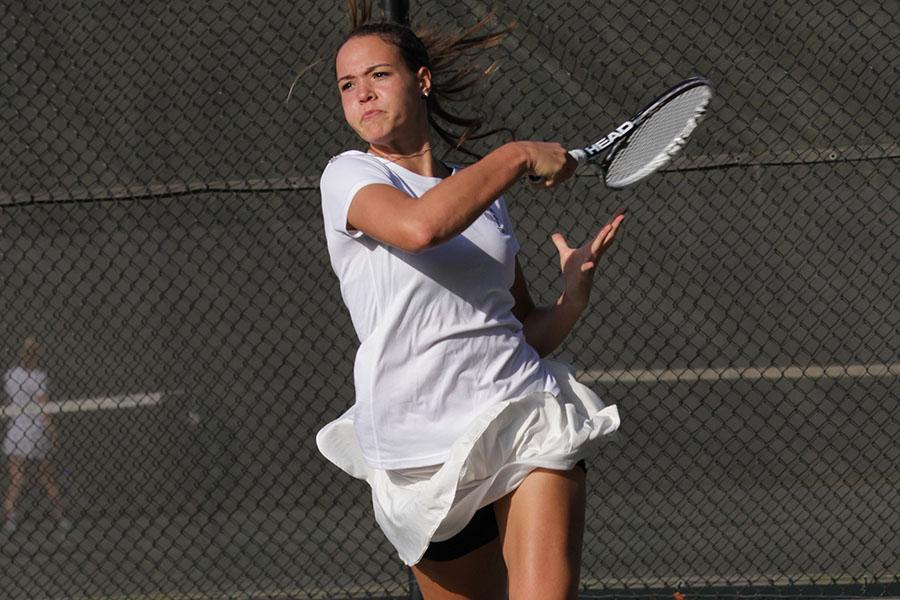 Junior+singles+player+Luisa+Schulte+hits+the+ball+on+her+way+to+victory.+Schulte+finished+undefeated+in+her+first+and+last+season+for+JC.