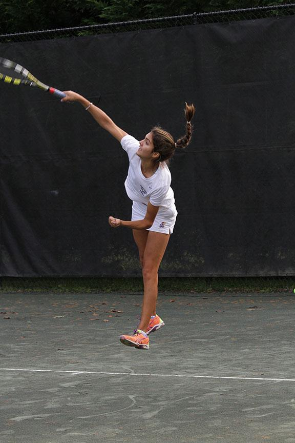 Sophomore Alexa Martinez serves the ball. JC won the tennis IAAM B conference championship.