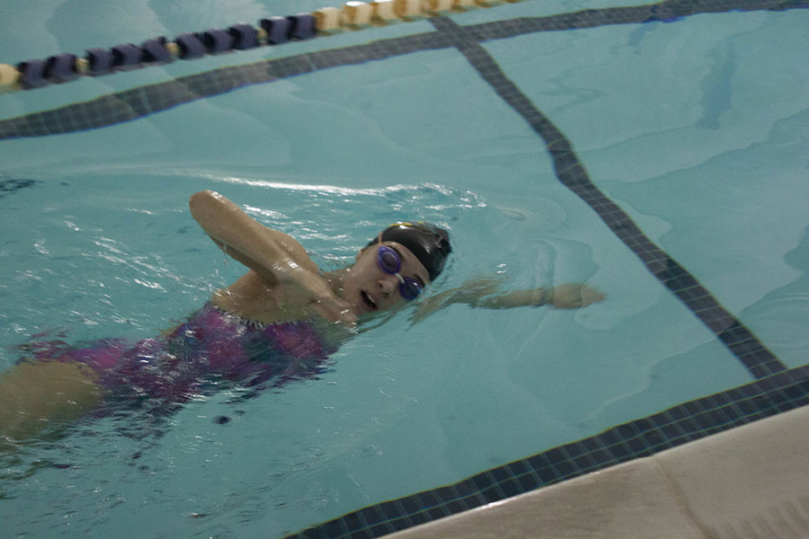 Junior Megan Piercy swims at practice preparing for an upcoming meet. Piercy has been on the swim team for three years.