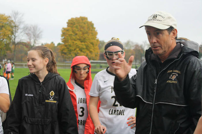 Varsity field hockey head coach Gary Scholl gives the girls advice during the game against Indian Creek on Oct. 29. Because of Scholl's coaching, the team made it to the championships on Nov. 1, beating Maryvale 2-1 in double overtime.