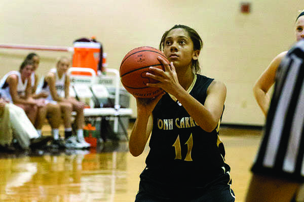 Freshman varsity point guard Savannah Simmons prepares to shoot a free throw in a game against Severn High School on Dec. 8. Simmons has won the state AAU championship twice for the Baltimore Stars.