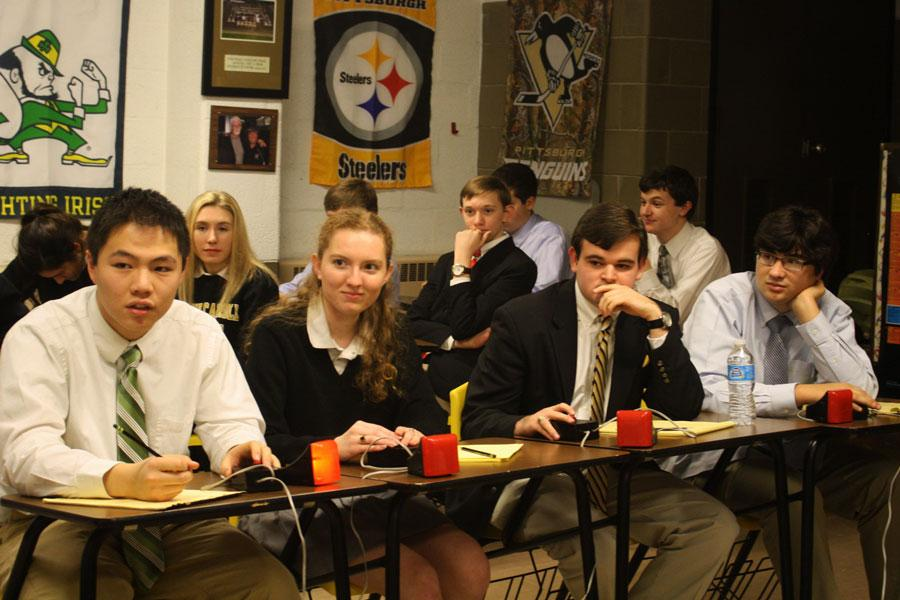 Senior Rawlison Zhang (left) buzzes in to answer a question in an Academic Team match against Mount de Sales on Dec. 9. The team, including Zhang, seniors and Patriot editors Kathy Deaver and Justin Hawkins, and junior Eric Wright (left to right) beat Mount de Sales 37-19.