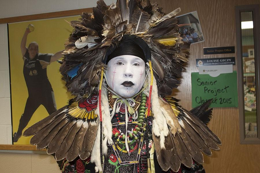 +A+male+dancer+from+one+of+the+Native+American+tribes+shows+off+his+traditional+regalia.+The+regalia+present+at+the+powwow+came+from+several+tribes+and+is+often+passed+down+through+generations.