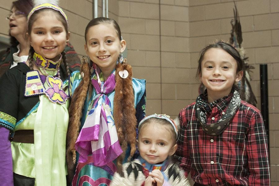 Young girls from various Native American tribes pose before getting ready for the grand entry. In the grand entry the girls danced in with their mothers in the direction of the sun.