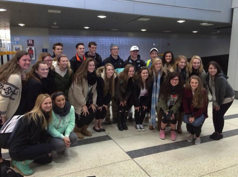 Students going on the Spanish exchange pose at the airport together. They will be in Spain for 19 days living with families there and learning their culture.