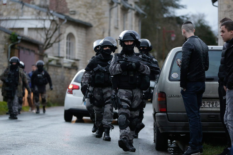 French police officers patrol north of Paris during the manhunt for the gunmen in the shooting at the satirical French magazine Charlie Hebdo headquarters on Thursday, Jan. 8, 2015. The two suspects reportedly robbed a gas station in the north of France.