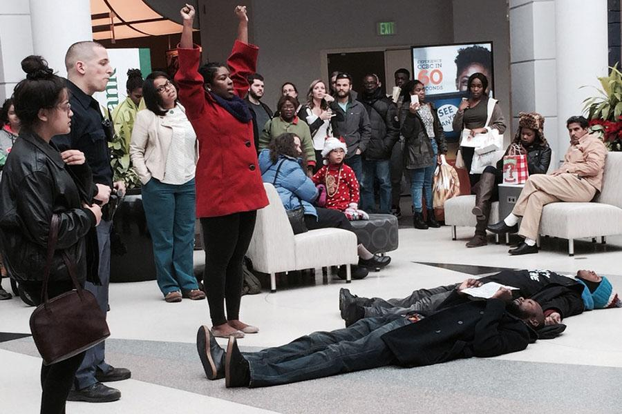 Protesters chant and lie down in the center of the Towson Town Center on Dec. 20. Across the country, protesters have spoken up against the recently publicized violence and police brutality shown against African Americans.