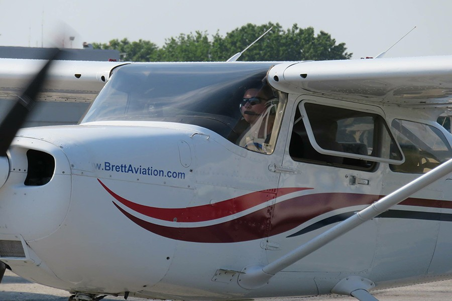 Junior Matt Lozinak sits in the pilot's seat getting ready for takeoff during one of his practice flights. Lozinak had to get in 40 hours of flying practice in order to get his pilot's license.