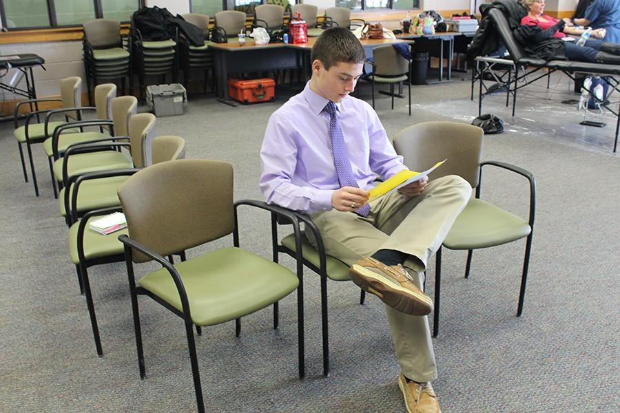 Senior Austin Kiss waits for his turn to give blood. The Blood Drive was sponsored by the Red Cross and held in the Brown room on Jan. 31.