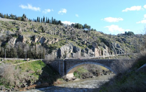 A bridge crosses the Tajo River. This river is the longest river in the Iberian Peninsula.