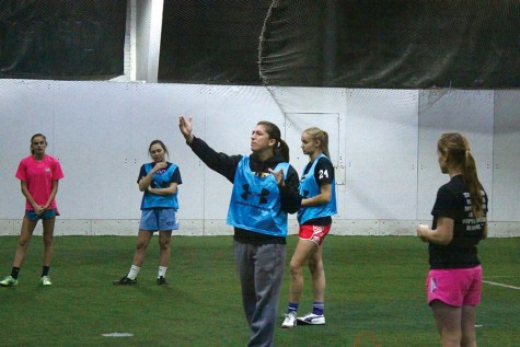 During practice at Maryland Sports Arena, indoor soccer coach Hayley Howe instructs her players on how to effectively pass through opposing defenses. The team lost to Garrison Forest 1-0 at championships Feb. 7.