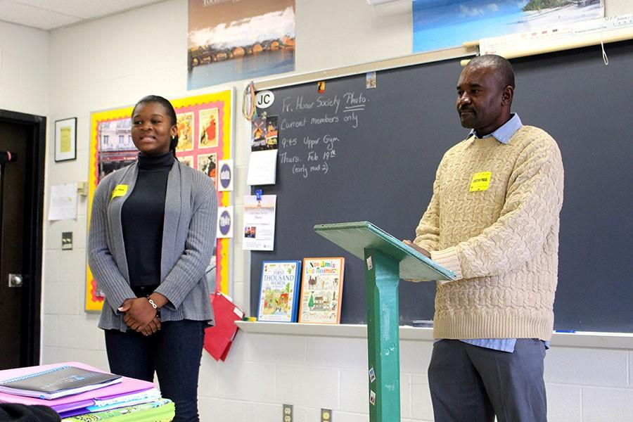 Speaking in French to French teacher Regina Ferry's class, Haitian natives Gabriel Thelus and his daughter Marie Gabrielle speak about the elementary school Thelus founded in Haiti. Some of the students in Ferry's class will be making booklets to send to Thelus's school, St. Rose of Lima, as a service project.