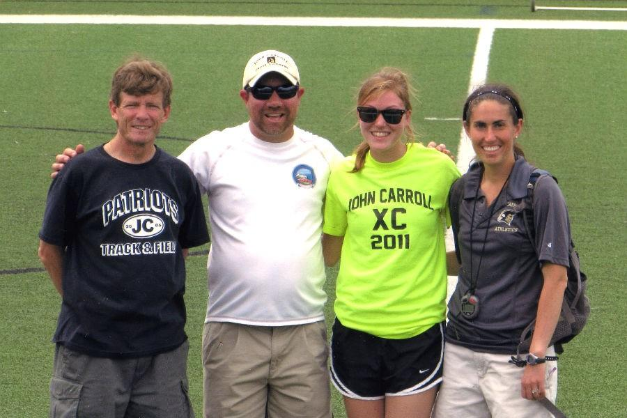 Math teacher and cross country coach Courtney Von Lange (far right) poses with senior runner Amanda Spaeth, class of '14, and coaches Mike Monaghan and Robert Torres after the last meet in 2013. Von Lange has worked and coached at JC since 2012.